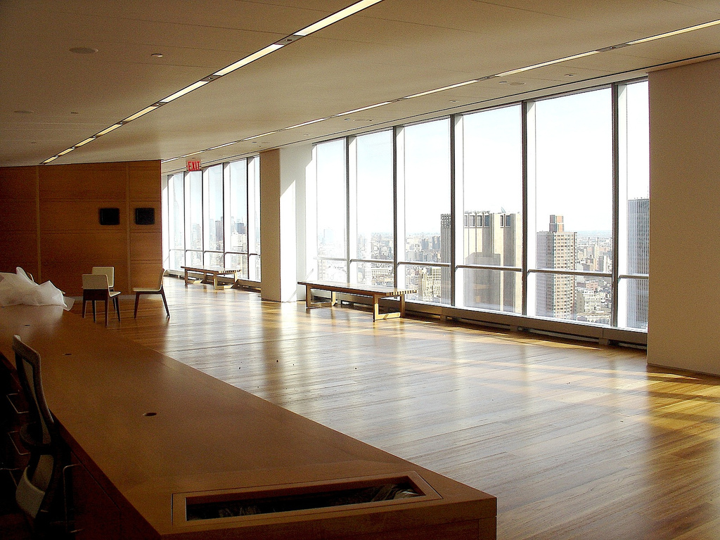 A large empty room with big windows at the new york for Large house windows