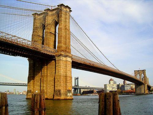 The Brooklyn Bridge Spans Across The Water.