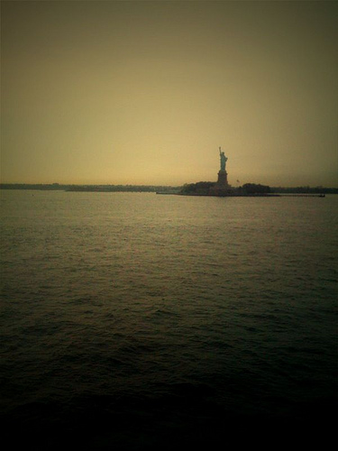 A View Of The Statue Of Liberty On Liberty Island Ny, From A Boat Travelling To Staten Island