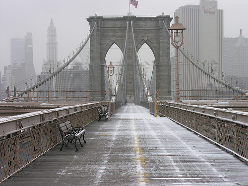 A Light Dusting Of Snow Covers The Brooklyn Bridge.