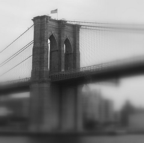 A Fuzzy Black And White Picture Of The Brooklyn Bridge