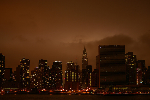 Glittering Manhattan Skyline At Night Featuring The Chrysler Building.
