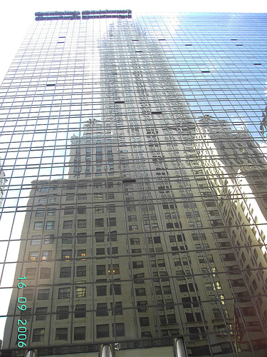 The Picture Of The Chrysler Building Is Reflecting On The Before Mirrors Building.
