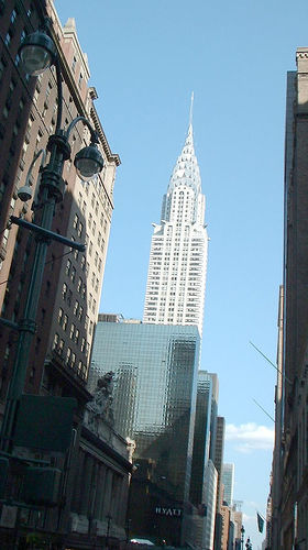 The Chrysler Building Stands High Among The Buildings Around It.