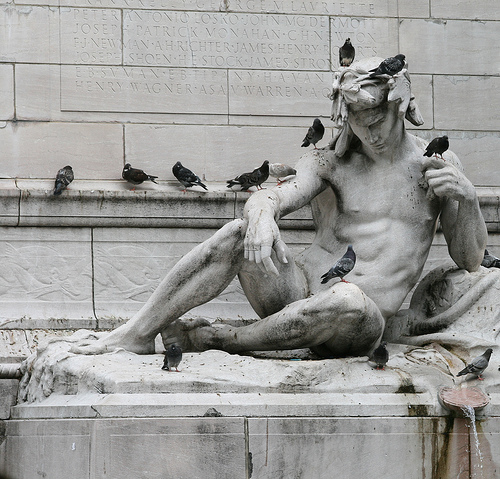 Birds Grace This Statue At Columbus Circle.