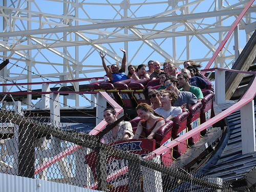 Riders Enjoy A Day At Coney Island By Riding The Cyclone