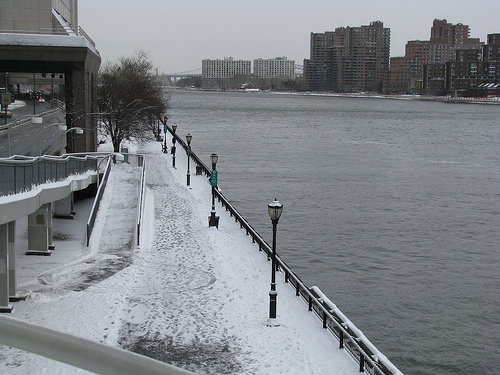 Snow Covers The Pedestrian Walkway Along The Banks Of The East River