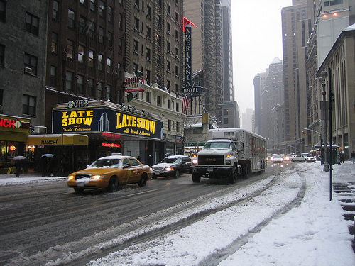 Traffic On A Snow Covered Road Outside The Ed Sullivan Theater.