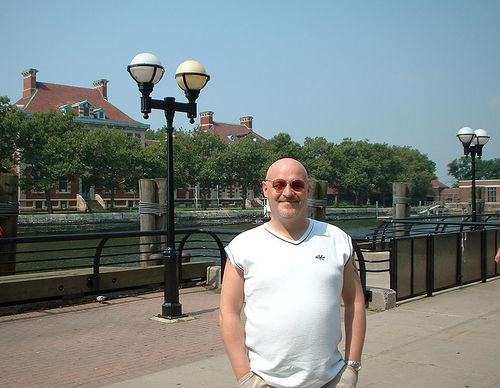 A Tourist Poses For A Picture On Ellis Island