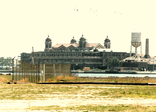 Looking Across Water Towards Main Building On Ellis Island,  Oddly Desaturated