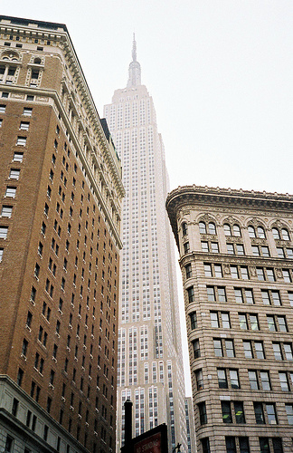 Empire Stat Building Seen Wedged Between These Two Buildings.