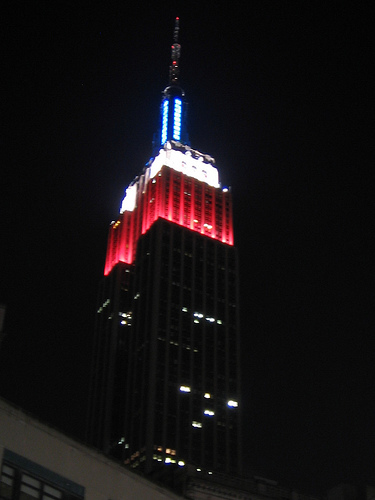 Peak Of The Empire State Building Lit Red White And Blue