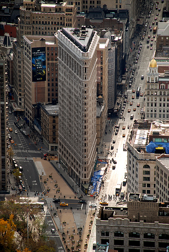 Busy New York City Moves Around The Old Flatiron Building.