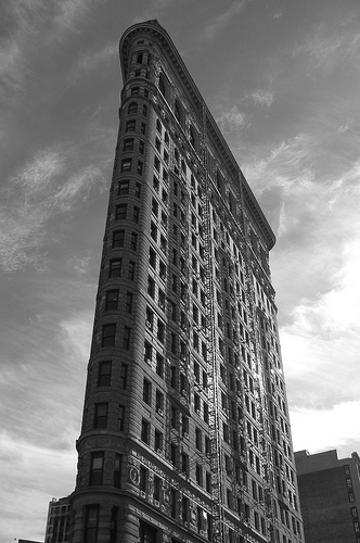 Looking Up A The Flatiron Building In Manhattan Against A Cloudy Sky