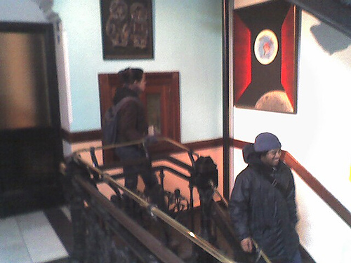 Two People Admiring The Art Work Inside The Hotel Chelsea