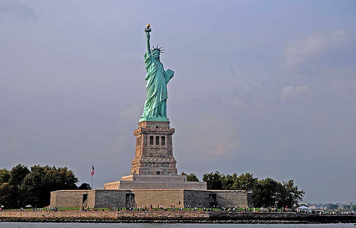 Lady Liberty Sits On Liberty Island With An Invite To Stop By.