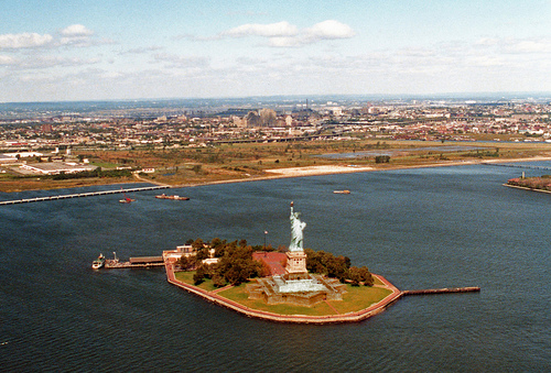 Breathtaking View Of Liberty Island On A Perfectly Sunny Day.