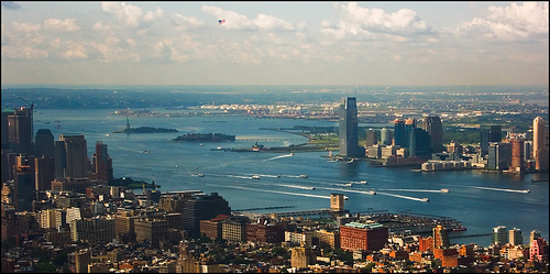 Liberty Island And Ellis Island Sit In A Busy New York Harbor