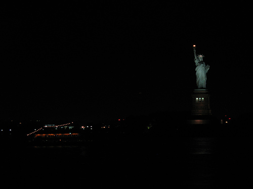 New York City Visitors Are Greeted By The Statue Of Liberty On Liberty Island.