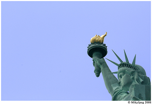 Statue Of Liberty Enlightening The World With The Torch And The Great Height With Spikes In Liberty Island