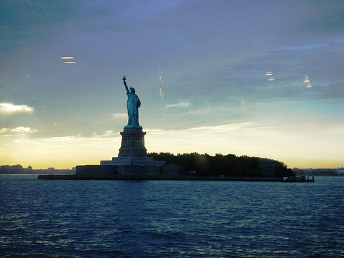 Sunset At Liberty Island, Home Of The Statue Of Liberty In New York City Harbor