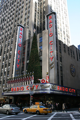 Music World Is The Radio City, Jump And Dance With Outstretched Hands