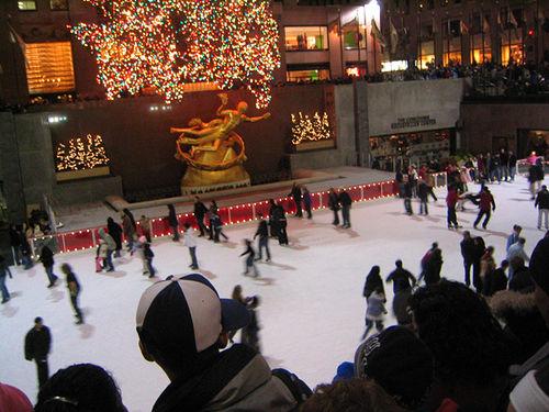 Ice Skaters Enjoying An Evening At The Rockefeller Center In Midtown Manhattan.