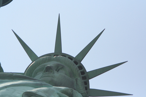 An Upward Look At The Face Of The Statue Of Liberty On A Beautiful Day.