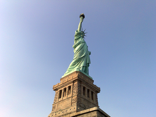 Made Of Pure Copper, The Statue Of Liberty Stands Tall Welcoming Visitors.