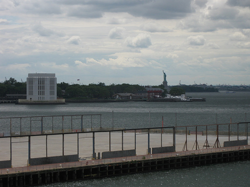 Distant View Of The Statue Of Liberty, Also Known As Lady Liberty.