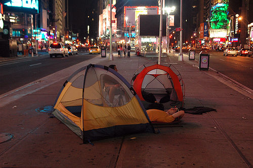 Campers Attempt To Snooze In Times Square, Heart Of The City That Never Sleeps.