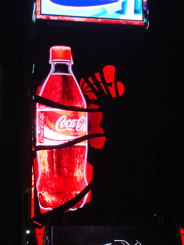 This Lit Up Coca Cola Bottle Is One Of Many Lighted Advertisements In Times Square