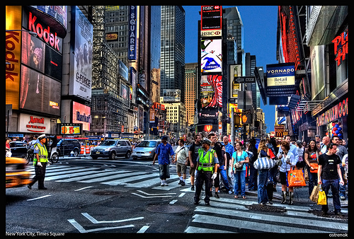 The Colorful And Bright Lights Of Time Square Welcome Visitors From Near And Far.