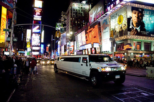 Interesting White Stretch Limo Driving Through Times Square.