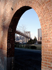 The Brooklyn Bridge In The Morning, Seen Through A Brick Arch