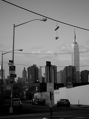 A Black And White Photo Of The City Featuring The Empire State Building