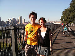 A Couple Poses During A Walk Along The Esplanade Promenade In Brooklyn Heights.