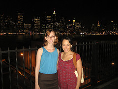 Nighttime Portrait Of Two Women Looking Towards Manhattan From Brooklyn Heights