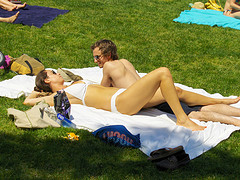 Sunbathing Couple In Central Park's Sheep's Meadow, Memorial Day Weekend
