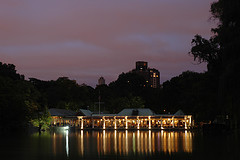Night View Of Lit-Up Building Across Pond In Central Park