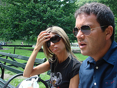 A Couple Takes A Break From Their Sight-seeing In Central Park.