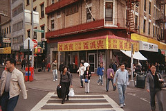 People Pass In The Streets Of Chinatown Manhattan