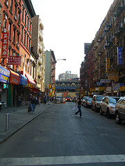 Female Crossing A Street In Chinatown, A Manhattan Neighborhood With A Large Population Of Chinese Immigrants.