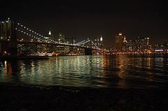 A View Of The Brooklyn Bridge At Night.