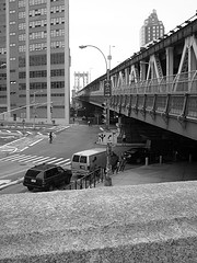 Black And White Perspective Photograph Looking Outwards On Manhattan Bridge.