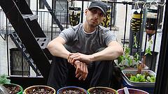 A Man Poses With Plants In East Village, Manhattan.