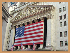 Flags On The Front Of The New York Stock Exchange In Lower Manhattan.