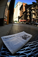 A Newspaper Sits On A Street Great In Manhattan's Financial District