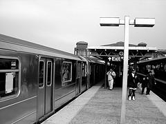 Black And White Photograph Of Junction Boulevard Subway Platform.