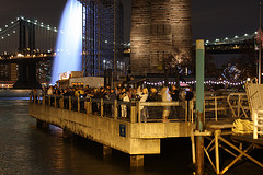 Fulton Ferry Is A Neighborhood In The New York City. People Photographing The Tribute Of Lights